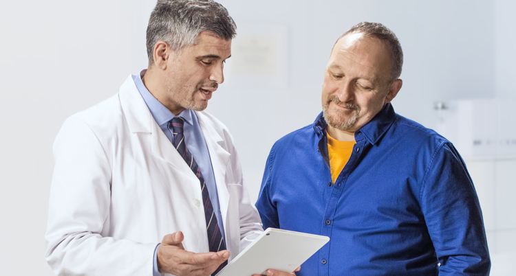 Man discussing his heart protection plan with VASCEPA® (icosapent ethyl) with his doctor