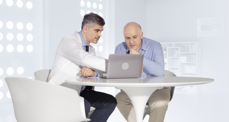 Doctor explaining to his patient how VASCEPA® (icosapent ethyl) can help protect his heart