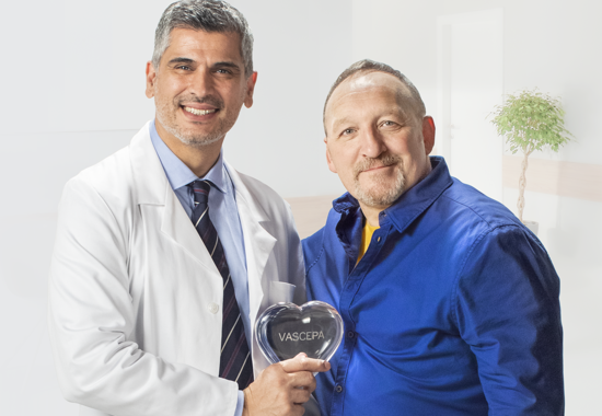 Doctor hold the clear VASCEPA® (icosapent ethyl) heart with his patient