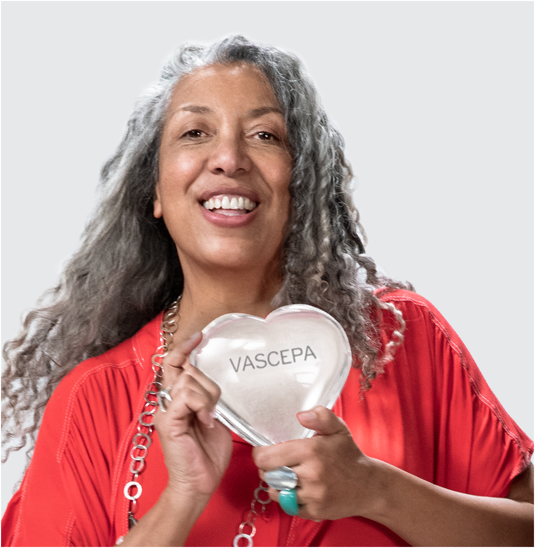Smiling woman holding the clear VASCEPA® (icosapent ethyl) heart