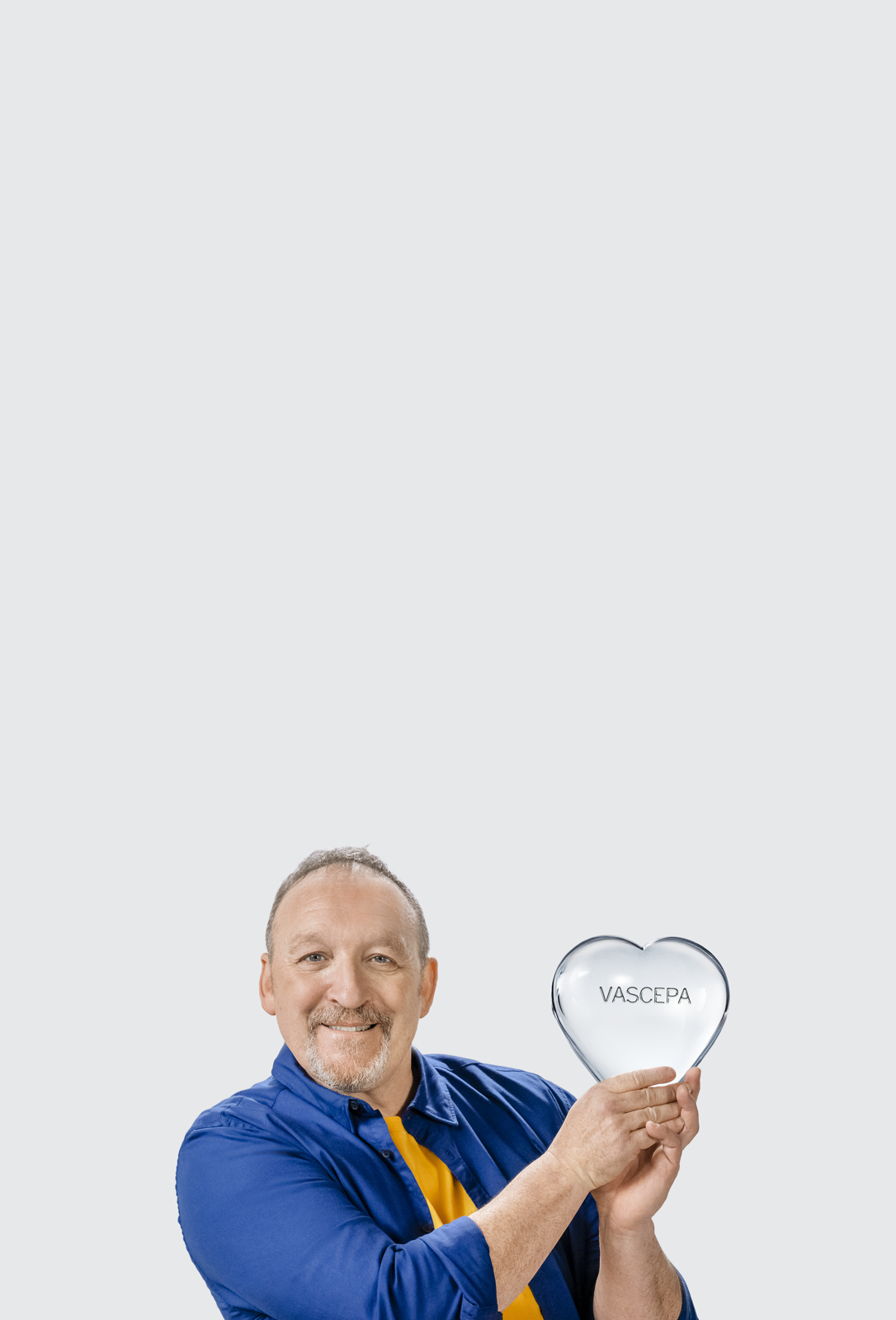 Man holding the clear VASCEPA® (icosapent ethyl) heart, celebrating 25% less more heart protection with VASCEPA® (icosapent ethyl)